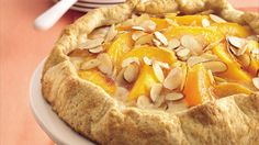 Enjoy this fold over coffee cake packed with peach slices and almonds – a…