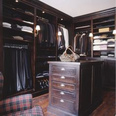 His! Dark stained wood closet, masculine dressing room, plaid chair