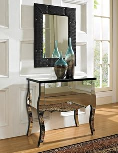Decorative Bottles On Sleek Mirrored Small Chest Of Drawer Design And Luxurious Framed Wall Mirror Idea