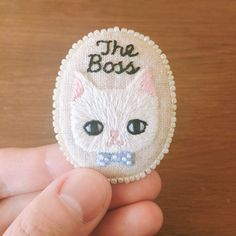 Hand-embroidered cat brooch by doalittledance