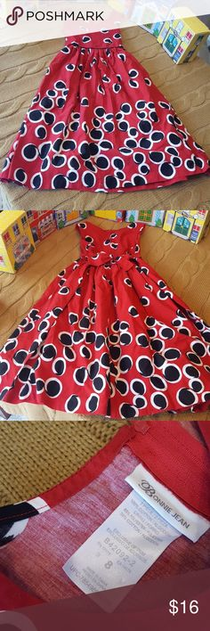 Girls size 8 red dress This gorgeous little dress, zips and ties in the back, flares out beautifully, has a bubble circle design on the fabric. It's a darker shade red with black and white accent colors. It's 100% cotton. Bonnie Jean brand. Excellent condition. Bonnie Jean Dresses