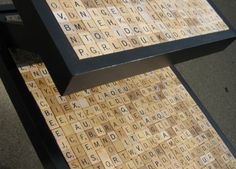 End tables from the 60s are perfect to repurpose. I just added scrabble tiles after I sanded this and painted it black.