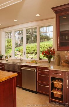 Idea of the Day: Dark Cherry-Colored Kitchens - Gallery. (By Crown Point Cabinetry). Very nice, dark wood cherry color gold accent island rattan Kitchen Colour Schemes, Kitchen Colors, Kitchen Layout, Kitchen Design, Kitchen Ideas, Color Schemes, Dark Wood Kitchens, Cool Kitchens, Crown Point Cabinetry