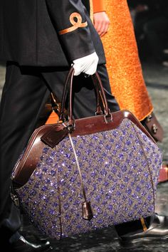 Want to carry for one night!  Louis Vuitton, purple
