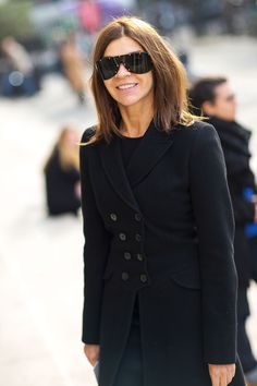 I don't know if she's over 50 but you just gotta' love her style.  Carine Roitfeld.