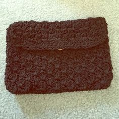 VINTAGE BLACK CROCHETED LIKE CLUTCH Super cute! Worn once-great condition! Has a pocket inside. Gold clasp snap shut!  Pretty spacious. Price is negotiable, just ask  Bags Clutches & Wristlets