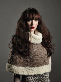 This knitted woman's stocking stitch cape accessory with Fur trim is worked in the round.  This design is from the brochure Big Accessories, designed by Martin Storey, using Thick 'n' Thin (merino wool) and Fur (wool). This pattern is for the intermediate knitter.