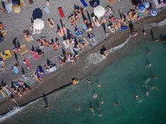 Russian beach: A drone hovers over Russian beachgoers in Abkhazia.    www.eklectica.in #eklectica