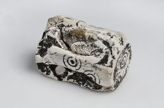 """Dice bone/antler from the Viking age. Unknown find spot, Sweden. Object from the exhibition """"We call them Vikings"""" produced by The Swedish History Museum."""