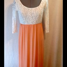 $1.99 SHIPPING Boutique Ivory and Coral Dress Scoop neck ivory lace stretch top with sheer sleeves. Skirt is coral t-shirt material. Worn twice. Dresses Maxi