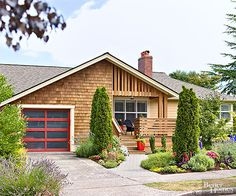 Like red doors? Then why not go for an eye-catching red garage door!