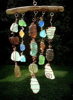 Sea glass rock collection turned into a mobile. could be done with Garrett's knapped arrows