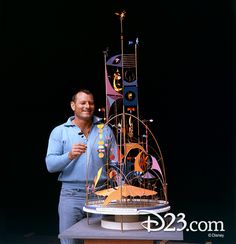Imagineer Rolly Crump with a model of the Tower of the Four Winds, 1964 World's Fair. Walt Disney Land, Walt Disney Imagineering, Disney Love, Disney Parks, Disney Pixar, Disney Icons, Disney Cast, Lord, Disney Artists