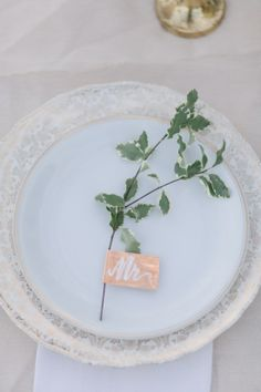 A simple sprig place setting is oh-so elegant.