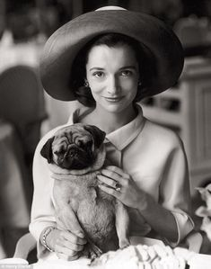 Lee Radziwill, younger sister of Jacqueline Kennedy, snapped by Henry Clarke in August 1960 with her pug Thomas, who used to accompany her to tea at the Ritz