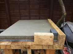 underneath the firebricks is a layer of vermiculite concrete. I also placed some insulating boards on top of the concrete before I put the proper firebricks on. I think the boards was something like calcium carbonate boards. very good for insulation as well.