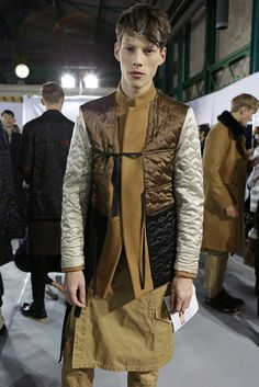 Wear a jacket inside out as seen backstage at Dries Van Noten Men's RTW Fall 2015. [Photo by Delphine Achard]