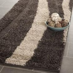 @Overstock - This power-loomed shag rug offers luxurious comfort and unique styling with a raised high-low pile. High-density polypropylene pile features a dark brown background with cream accents and provides one of the most plush feels available in a rug.http://www.overstock.com/Home-Garden/Ultimate-Cream-Dark-Brown-Shag-Rug-23-x-7/6372222/product.html?CID=214117 $49.29