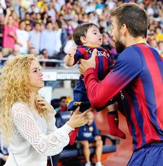 Shakira and her husband Gerard Pique of FC Barcelona are seen with their son Milan Pique
