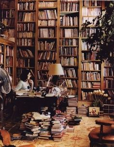 Nigella Lawson, likes having all her favorite books within arm's reach -- Check out the workspaces of these 9 famous #writers and artists, then share your favorite space using the hashtag, #writespace: