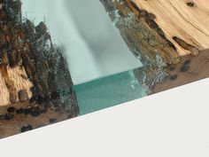 Jetty is coffee table made in resin and briccola, a surface area of transition between liquid and solid. A floating space where wood and water are spoken