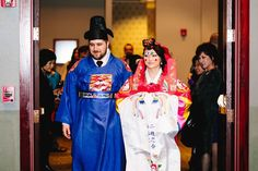 Bride and groom in colorful wedding hanbok. Red, White, and Gold: A Pretty Bicultural Wedding | Stonegate Conference and Banquet Centre | Jordan Imhoff Photography