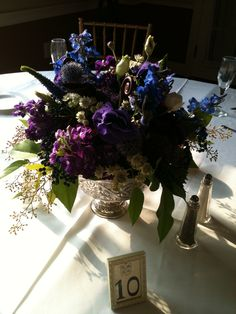 Venue: Penn Ryn Mansion antique silver bowl-filled  with purple stock,delphinium blue,white astrantia,seeded euk,blue thistle,veronica purple,purple lisianthus,lavender roses