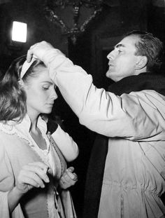 The exacting Luchino Visconti gets Alida Valli's hair just right for a scene of Senso.1954