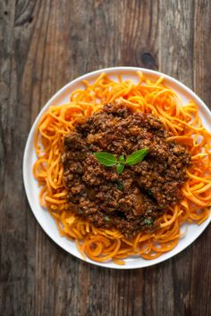 Slow-Cooked Bolognese Sauce with Sweet Potato Spaghetti + over 63 Whole30 Dinner Recipes #paleo
