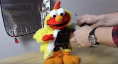 This dancing and singing Elmo gets a new look and sound with some clever electronics hacking.