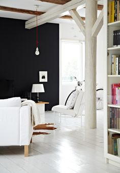 black wall / wood column