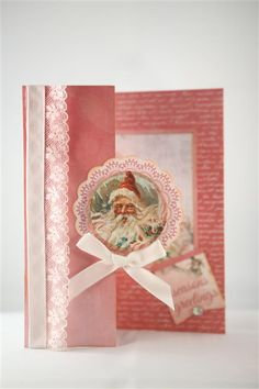 "Kaisercraft Silver Bells once again, this time the pink tones of the paper. I used the papers from the 6"" pad for this one, and as for the previous card folded the front of the card back on itself...."