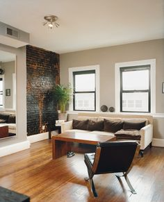 taylor gormet deli mazza david living room (way of dealing with wood + exposed brick... beige walls, white sofa)