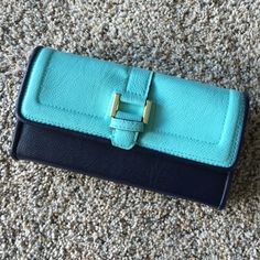 two toned wallet Vibrant robin's egg and navy blue wallet. Super clean navy fabric interior with 22 card slots, zipped middle compartment as well as two interior and 1 external slide pockets. Goldtone hardware. Minor wear on edges (see pic #4.) shell: non-leather material. Excellent condition! HL:6 Merona Bags Wallets