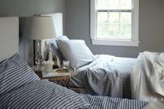 Striped Bedding - Cottage - bedroom - Benjamin Moore Cape May Cobblestone - Trisha Foley Wicker Shelf, Wicker Table, Wicker Sofa, Wicker Furniture, Wicker Dresser, Wicker Trunk, Wicker Mirror, Wicker Planter, Table Lamp