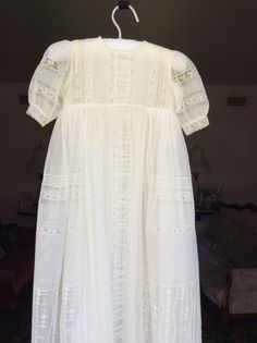 This is an original antique lace Christening gown I designed for my grandson.I Will happy to make your Baby something special too.