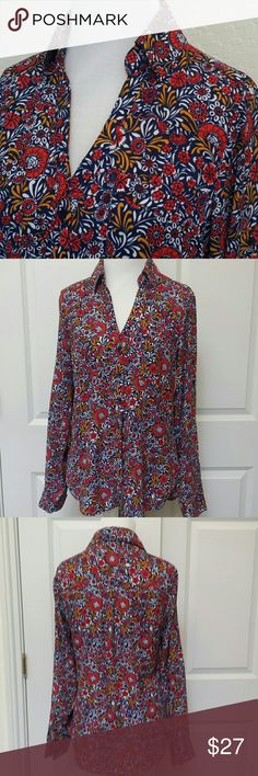"""Portofino Slim Fit Shirt This shirt has vibrant, beautiful flowers and print in orange, white, mustard yellow, and navy blue. Super cute all year round, and very comfortable. Has two front pockets and the sleeves can be worn down or rolled up and tabbed. EUC  Length front: 22 1/2"""" Length back: 25"""" Armpit to armpit: 18"""" Express Tops Button Down Shirts"""