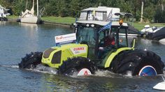 Mitas tires walk on water Trelleborg Claas Axos 320 high-horsepower Trek...