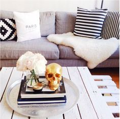 SOOOOO in love with the gold skull just chillen. via Four Fabulous Ways to Style Your Coffee Table