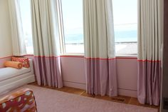 Girls Bedroom - Custom Drapes by Lynn Chalk with border and ribbon trim carefully lined up with painted border on wall. Bed and Lumbar Pillow covered in Christopher Farr Fathom in Hot Pink.