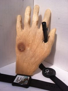 Sometimes you need an extra hand for display purposes. My carved wooden hand.