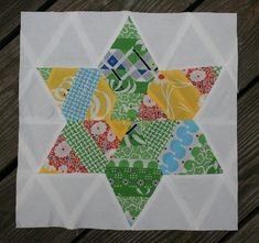 Welcome back! I hope everyone had a relaxing weekend--ours was more of the hit-the-floor-running-and-don't-stop kind of weekend. Today, I have a tutorial for block #7--the Six-Pointed String Quilt-...