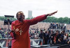 Archbishop Desmond Tutu of Cape Town smiles as he gestures from a platform during the Nelson Mandela Freedom Rally in London's Hyde Park, on July 17, 1988 - on the eve of the jailed African National Congress leader's 70 birthday. A crowd estimated at 250,000 attended the rally. (AP Photo/Gill Allen) African National Congress, Desmond Tutu, Fight For Justice, We The Kings, Lest We Forget, Nelson Mandela, Civil Rights, King Queen, Human Rights