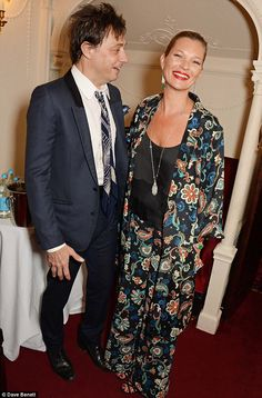 Back stage laughter: Kate is joined by husband Jamie Hince, who wears a tie for the occasion