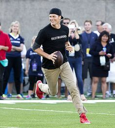 Tom Brady played a Best Buddies charity touch football game in Allston, Mass., on May 29.