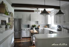 Cabinet and Trim Color: London Fog in Semi-Gloss Wall Color: was here but very similar to Simply White in Matte --Our Kitchen Makeover on a Budget (Phase 1)  by Dear Lillie