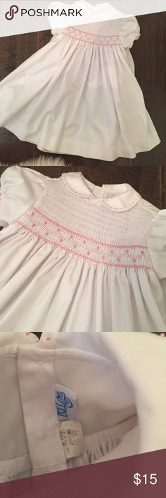 Smocked dress 9-12 mos Beautiful embroidered white and pale pink dress. Bought from a sale but won't fit my baby's arms! Absolutely precious..No stains Luli & Me Dresses