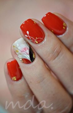 Another beautiful red ensemble that looks very simple yet eye catching. Plain red reds with a does of white flowers and gold beads are perfect when you wish to have classy and simple looking nails. Very easy to maintain and repaint. This is great for those who would like to keep low profile nails but still stay in the nail art fashion.