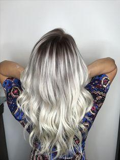 Platinum blonde with dark shadow root.