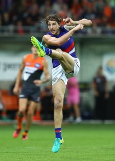 Marcus Bontempelli of the Bulldogs kicks during the AFL First Preliminary Final match between the Greater Western Sydney Giants and the Western. Australian Football League, Western Bulldogs, Great Team, Athletic Men, Rugby, Doggies, Sydney, Athlete, Champion